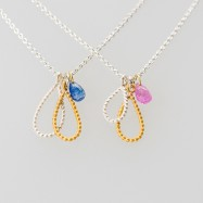 Sapphire briolette pendant with pink or blue sapphire